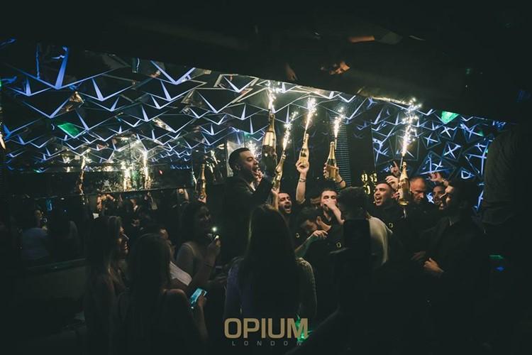 Opium nightclub London fun table service alcohol bottles vodka rum champagne expensive celebration