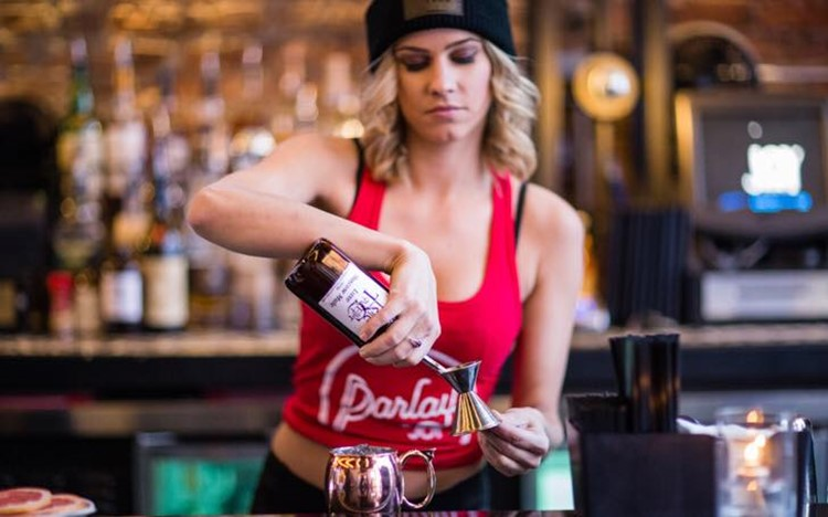 Parlay sports club Chicago sexy blonde bartender pouring shots alcohol drinks