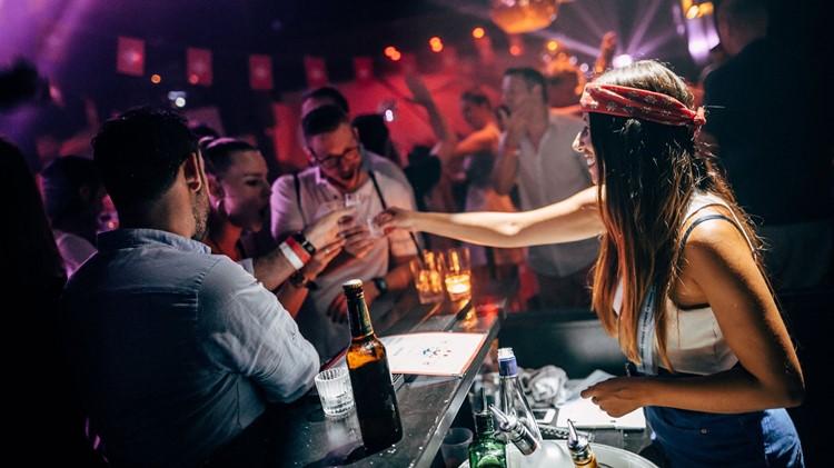Plaza Klub nightclub Zurich sexy bartender serving alcohol drinks bottles vodka champagne