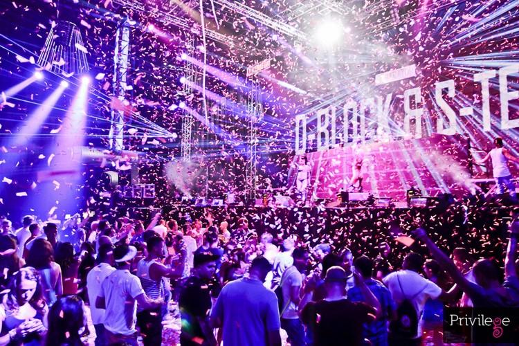 Privilege nightclub Ibiza crowd having fun at event confetti