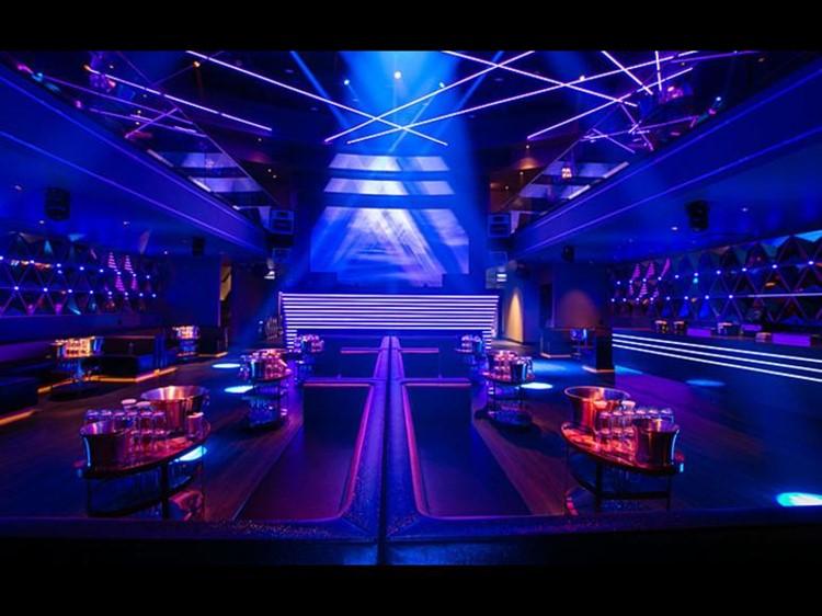 Prysm nightclub Chicago lounge area vip table alcohol bottles