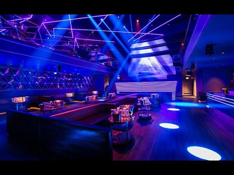 Prysm nightclub Chicago lounge area alcohol bottles