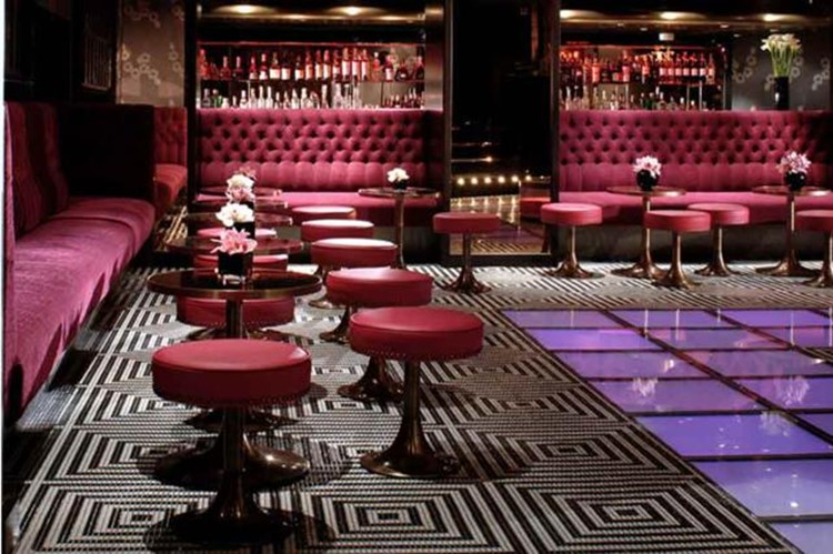 raffles nightclub london view of the entire club elegant luxury interior design colorful patterns black white purple and blue