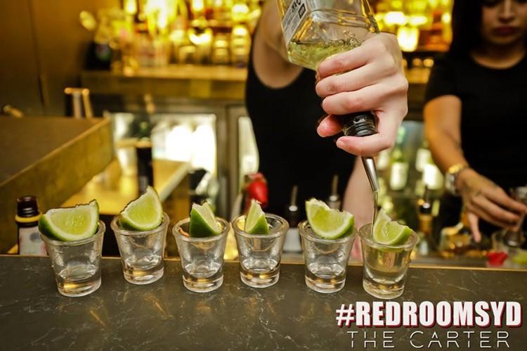 Red Room Club nightclub Sydney alcohol drinks barman shots bottle vodka champagne