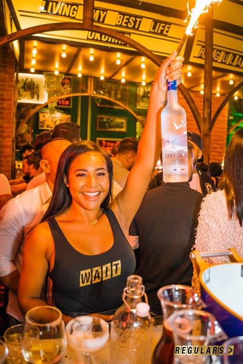 Regulars Bar club Toronto sexy waitress serving alcoholic drinks