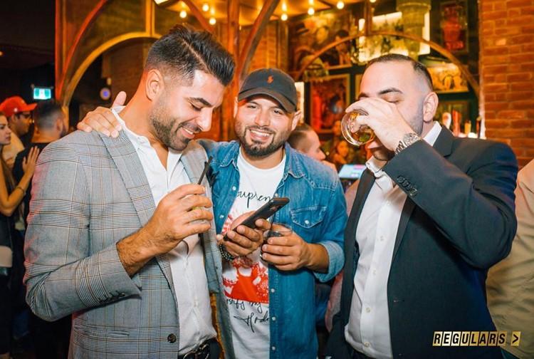 Regulars Bar club Toronto hot men drinking alcohol expensive champagne