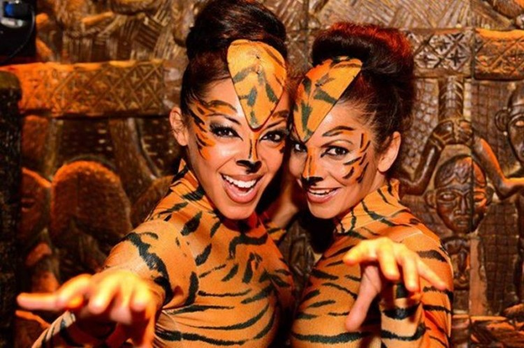 Shaka Zulu London club restaurant girls dressed as tigers costumes facial make up