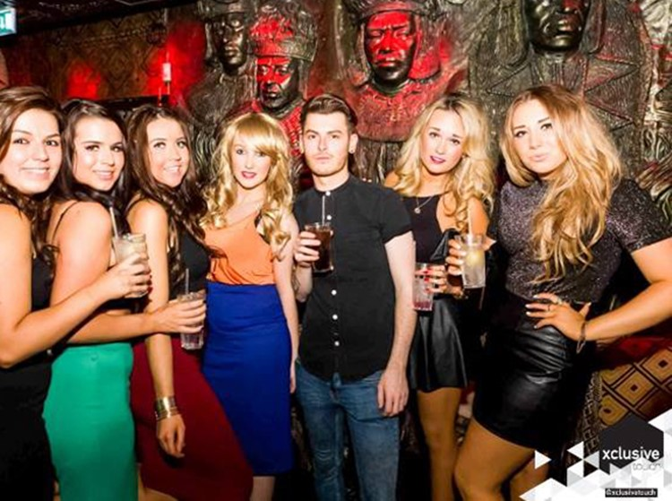 Shaka Zulu London club restaurant group of pretty blonde and brunette girls having drinks