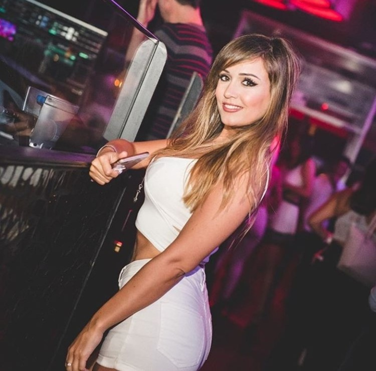 Shoko nightclub Barcelona blonde girl dressed in sexy white mini dress