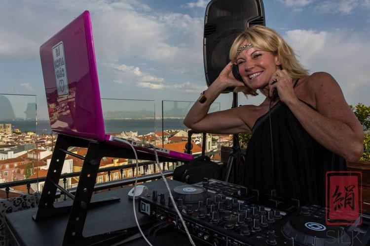 Silk Club nightclub Lisbon blonde dj girl having fun mixing music