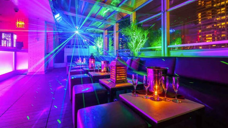 Sky Room nightclub New York City rooftop club view of the inside lounge area colored lights