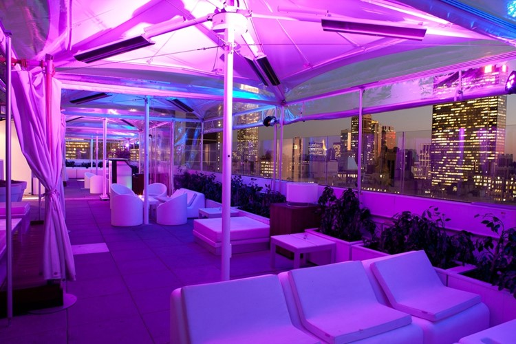 Sky Room nightclub New York City rooftop club outside umbrellas and lounge area