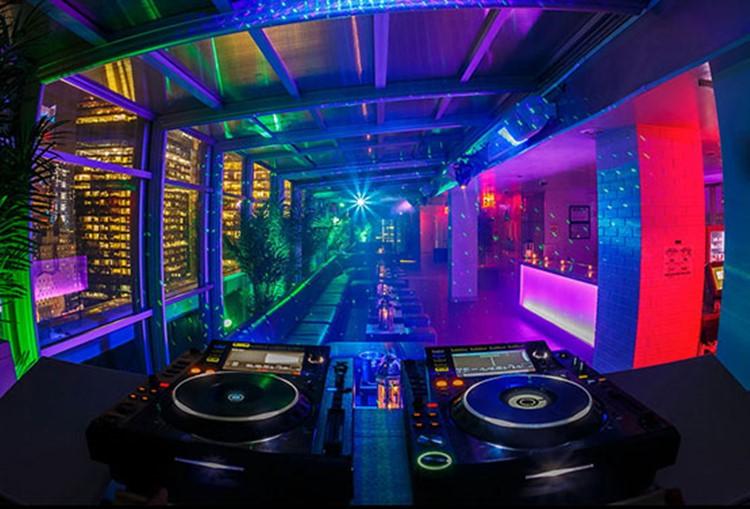 Sky Room nightclub New York City rooftop club inside rooms dj view dance floor colored lights