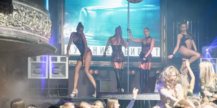 Soho Rooms nightclub Moscow exotic dancers in sexy black leather bodysuits lingerie