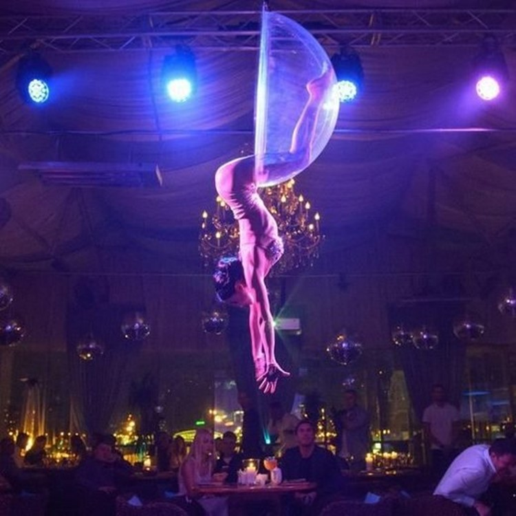 Soho Rooms nightclub Moscow exotic dancer acrobat hanging from the ceiling in ring