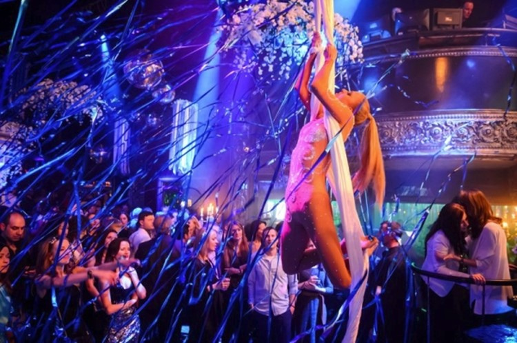 Soho Rooms nightclub Moscow dancer hanging from white ropes