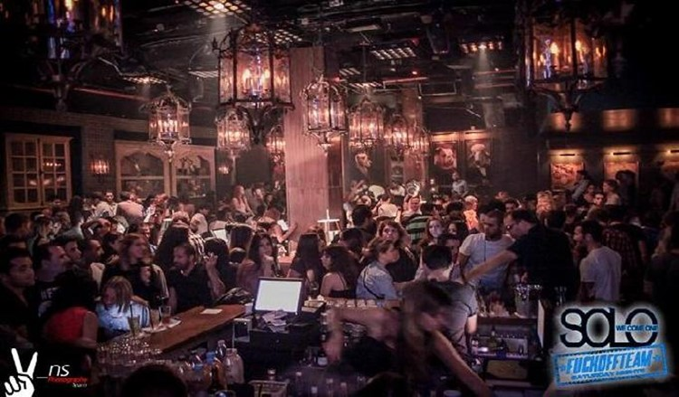 Solo Club nightclub Tel Aviv view of the full club crowd having fun chandeliers