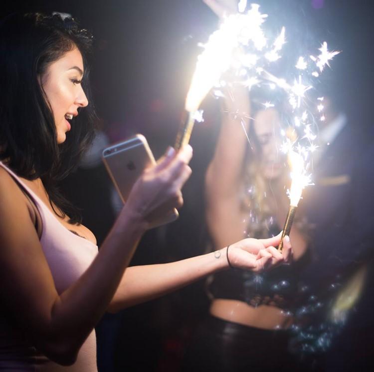 Somwhr Liquor Lounge nightclub Montreal brunette girl holding firework