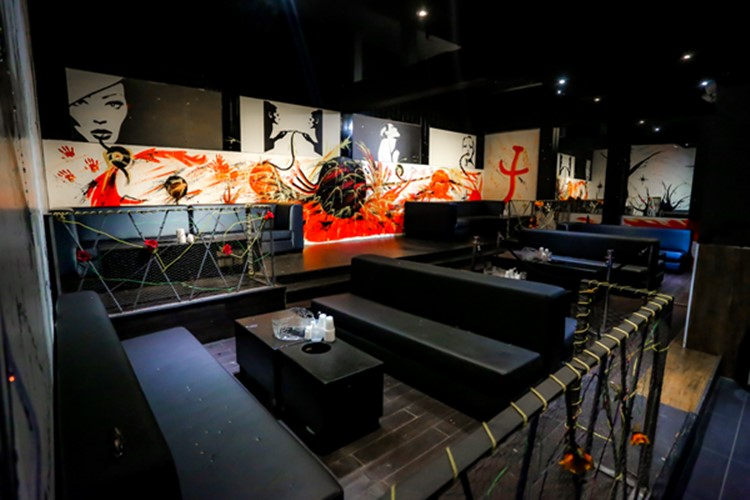 Stadium nightclub Toronto view of lounge area abstract painted walls orange red black interior design
