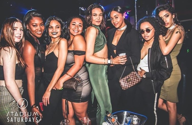 Stadium nightclub Toronto group of brunette girls having fun