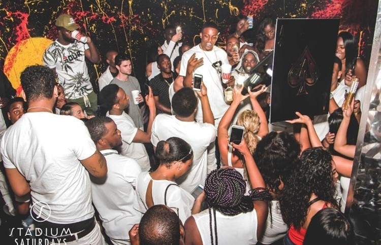 Stadium nightclub Toronto crowd dressed in white at party concert