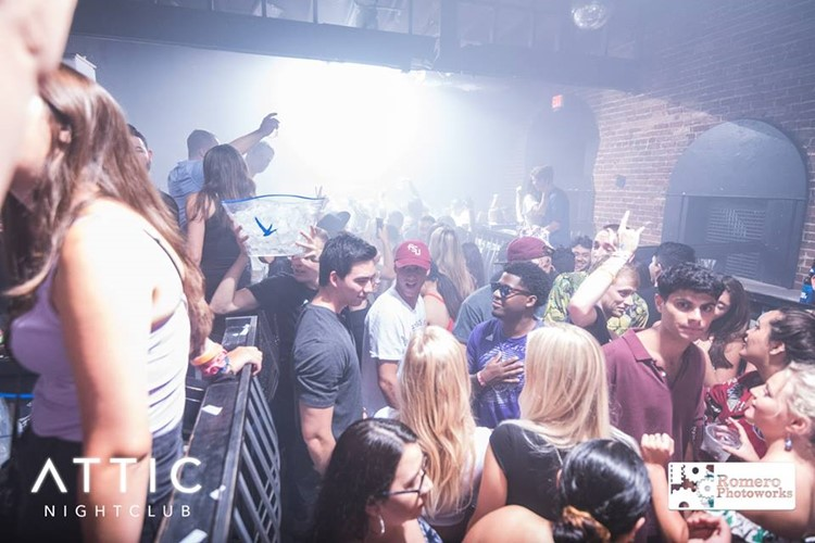 The Attic Club nightclub Orlando party people drinking alcohol