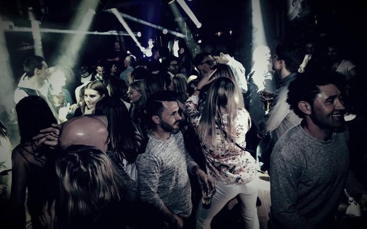The Club nightclub Oslo people dancing having fun drinking
