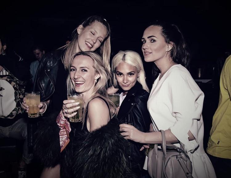 The Club nightclub Oslo sexy blonde girls having fun dancing alcohol bar