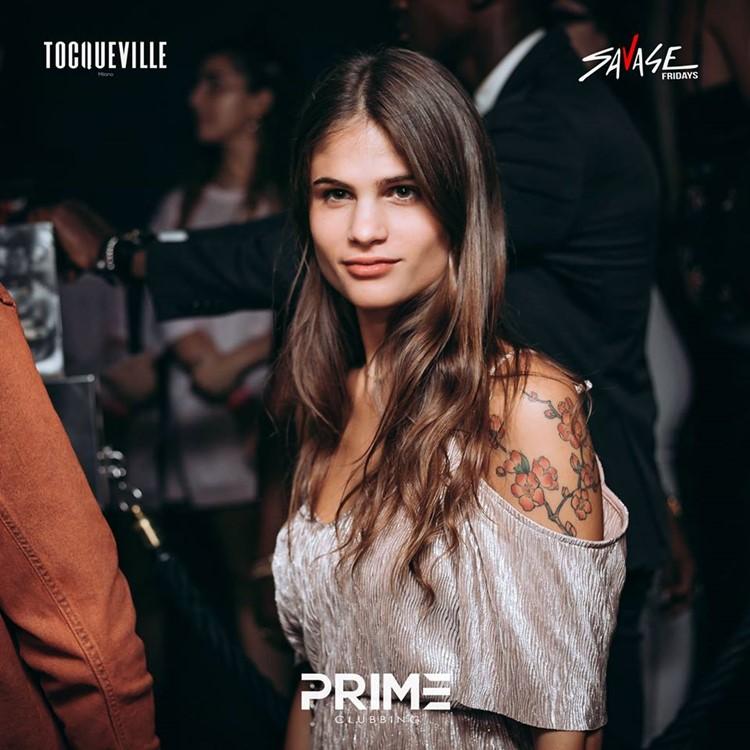 Tocqueville 13 nightclub Milan brunette girl dancing drinking