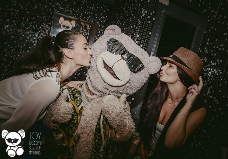 Toy RoOm nightclub Mykonos pretty brunette girls kissing mascot teddy bear