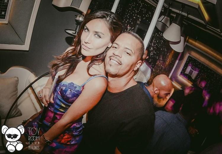 Toy RoOm nightclub Mykonos pretty brunette green eyes woman with a boy friend having fun
