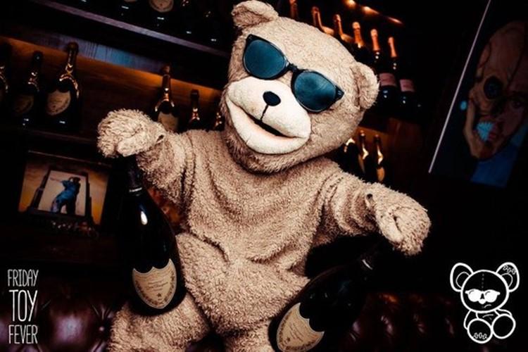 Toy Room nightclub Dubai mascot teddy bear holding champagne bottles