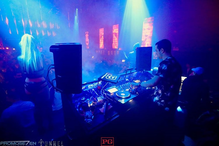 Tunnel nightclub Chicago dj mixing music crowd party fun exotic dancer stage show