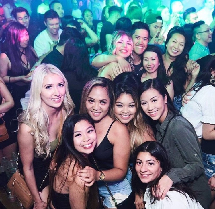 Uniun nightclub Toronto group of pretty brunette and blonde girls hugging