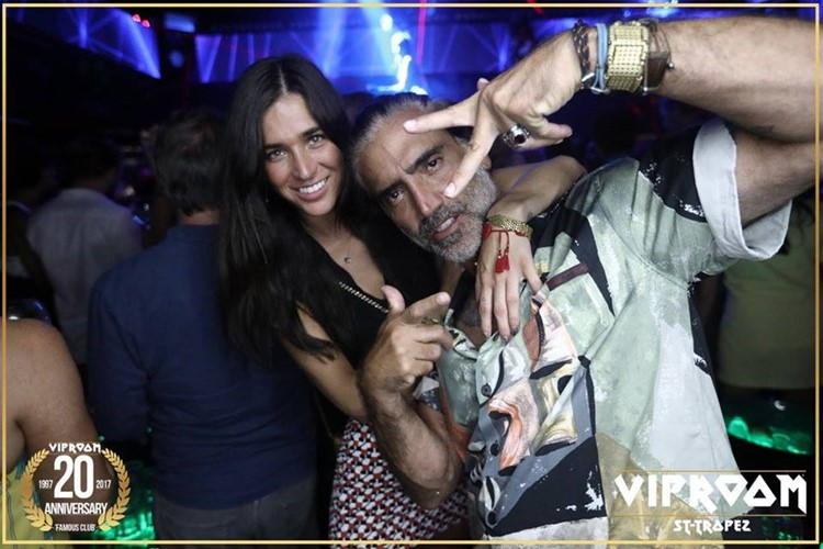 vip room st tropez nightclub drunk couple having fun at a party grey hair man with pretty brunette blue eyed woman