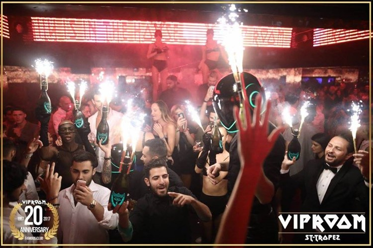 vip room st tropez nightclub private vip night party celebrating with many alcohol champaigne bottles rich men having fun