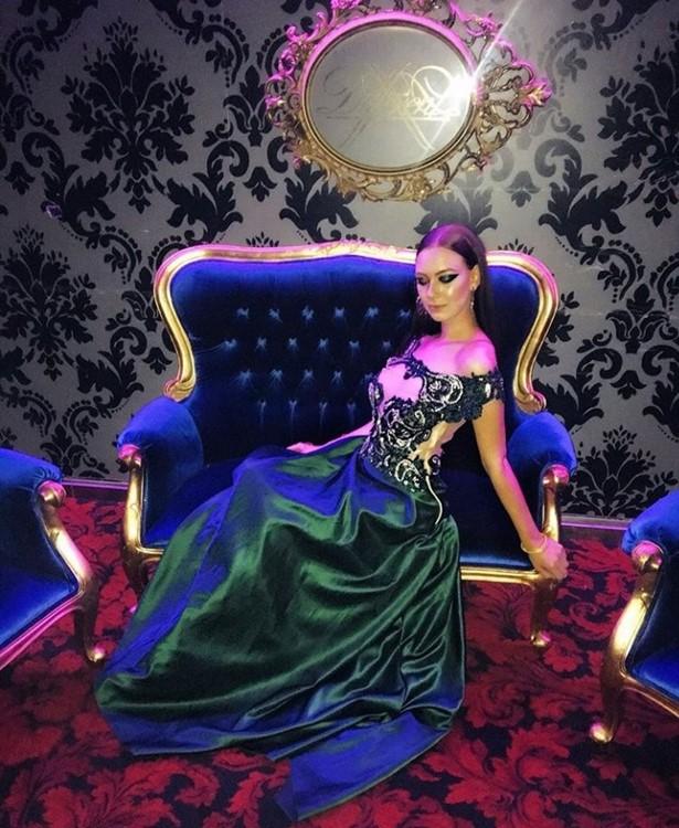 VIP Room nightclub Paris pretty brunette girl dressed in elegant emerald green long dress