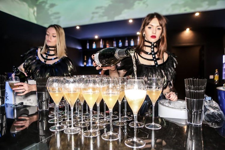 Vog nightclub Paris waitresses pouring drinks champagne luxury bubbles alcohol