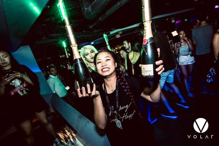 Volar nightclub Hong Kong pretty chinese waitress holding big champagne bottles