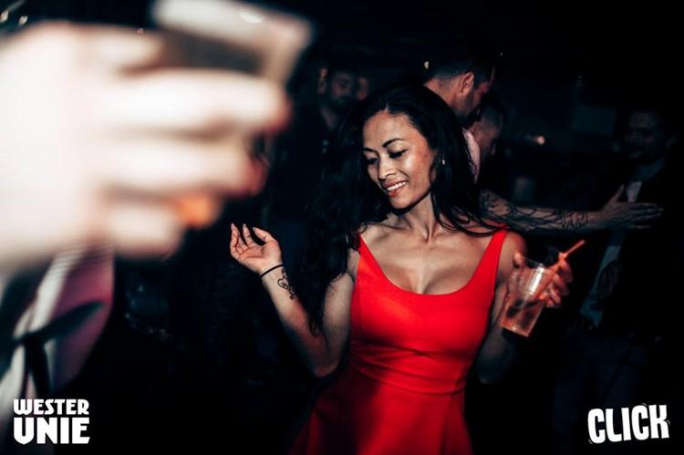 WesterUnie nightclub Amsterdam pretty brunette girl dancing in sexy red dress