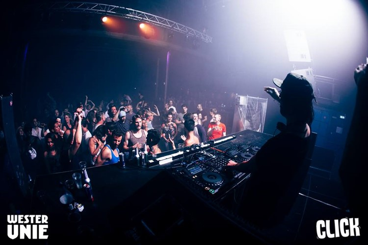 WesterUnie nightclub Amsterdam crowd with hands in the air having fun at concert show