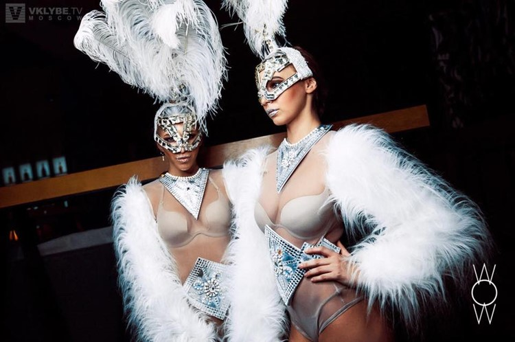 WoW nightclub Moscow two exotic dancers dressed in white fur