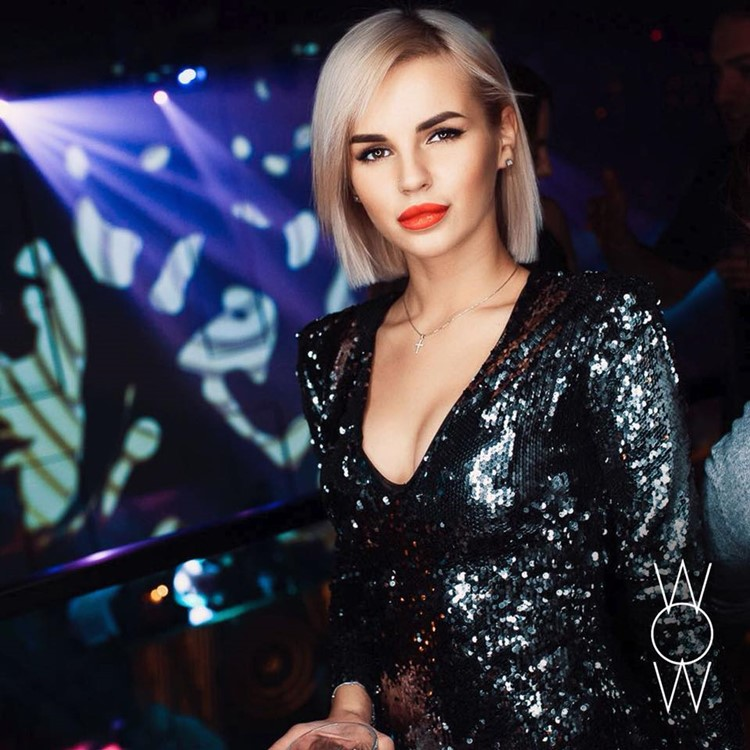 WoW nightclub Moscow beautiful blonde girl dressed in sparkly dress