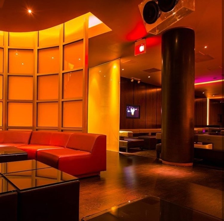 Ybar nightclub Chicago lounge area bright lights brown interior design